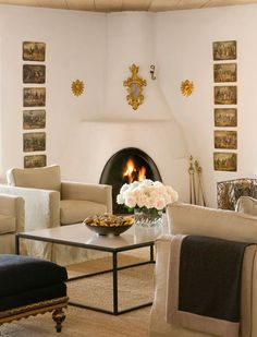 Mini starbursts and processional crosses surrounding fireplace