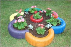 Create whimsical DIY garden art to liven up your garden. From repurposed planters to garden decorations from junk, there are plenty of unique garden art ideas to choose from. Garden Crafts, Diy Garden Decor, Garden Projects, Garden Art, Garden Design, Garden Decorations, Art Projects, Tire Planters, Flower Planters