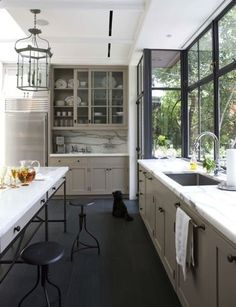 grey cabinets.  This works for me because of the dark floors and dark trim.