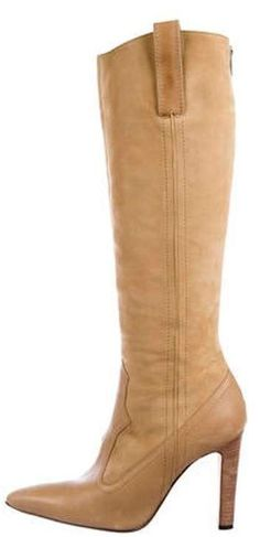 Tan suede Manolo Blahnik high-heel mid-calf boots with pointed toes, wooden stiletto heels and zip closures at back. Designer Fit: This style typically runs a full size small. Suede Boots, Heeled Boots, Stiletto Heels, High Heels, Manolo Blahnik Heels, Draped Skirt, Tracy Reese, Mid Calf Boots, Calves