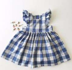 Vintage inspired pale pink gingham pinafore with a 3 wooden button closure down the back. Ready to Ship!
