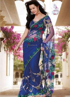Famous Designers Tend To Give Reign To Their Imagination And Create Clothes That Look Interesting And Guided By The Desire To Attract Attention. All Of This Accenting The Feminine Beauty & With This Navy Blue Net Saree. Look Ravishing Clad In This Attire Which Is Enhanced Lace, Multi, Resham & Stones Work.