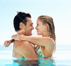 Joyful couple in swimming pool