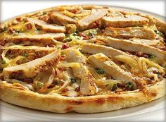 Chicken Pizza(Pizza al Pollo)   Topping:  *2 chicken breasts, thinly sliced  *15ml olive oil  *30ml/2tbsp tomato puree  *5ml/1tsp chopped basil  *100g/4oz Mozzarella cheese  *50g/2oz/1/2 cup Parmesan cheese, grated  Method:  1.Prepare the dough  2.Cover and leave in a warm place for 1/2h  3.Fry the chicken 2 min.Spread the dough with the tomato puree and sprinkle with the basil.  4.Lay the chicken slices over the top.Place the Mozzarella.Sprinkle Parmesan cheese.  5.Bake for 7-15 minutes.
