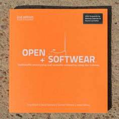 a book about Arduino boards, conductive fabric, resistive thread, soft buttons, LEDs