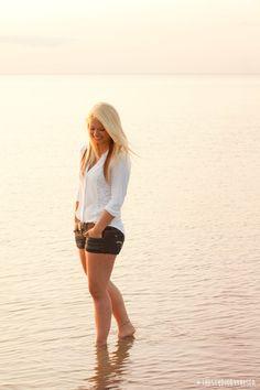 Cape Cod senior photos, senior girl in ocean at sunset, relaxed senior pose