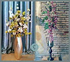 Vertical floral arrangement in metal vases