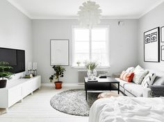 Yes, It's Possible to Live Well in a Studio Apartment—Here's How - A palette of bright whites and grays emphasizes the flood of natural light coming from this home' - Studio Living, My Living Room, Home And Living, Living Spaces, Living Area, Studio Apartment Decorating, Apartment Interior Design, Home Interior, Deco Studio