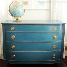 ASCP Aubusson Blue with clear wax finish.  Love the colour, the way it was distressed and the brass hardware.