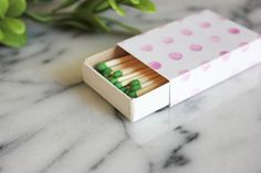 i heart matches. matchbooks, matchboxes, long ones, short ones.. they are small, easy to collect, and a can add nice touch to your home, your event, or even gifts. problem. the really good looking ones are out of my match buying budget. so i made some covers for the cheapy brand you can buy anywhere