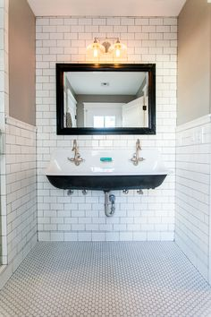 Trough sink on subway tile walls with warm gray grout - by Rafterhouse.