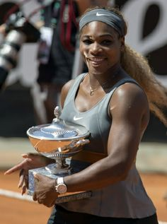 Serena Williams smiles as she holds the trophy after winning the final match against Italy's Sara Errani at the Italian open tennis tournament in Rome (AP)