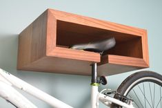 Does your dad like to pedal? Help him store his wheels in style with this wood bike-rack with shelf! Mom will love that the thing lifts icky tires off the ground; ) $255 via @etsy