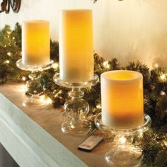 Flameless Indoor Candles. Love these glass pedestals