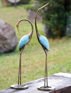 So beautiful! Love the aqua accent against the metal, and the curve of the necks.