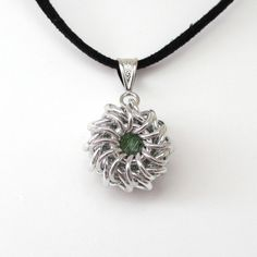 Chain mail pendant Whirlybird with peridot  Swarovski crystal by TattooedAndChained, $25.00