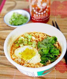 noodle bowl: instant ramen noodles with poached egg, sri racha sauce and scallions. pickledplum.com food recipes