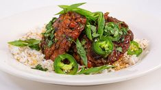 This braised chicken dish is the ultimate Filipino comfort food, a saucy dish of dark meat spooned over rice & garnished with fresh greens.