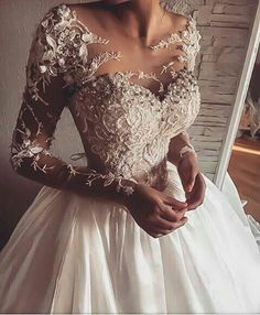 Haute couture wedding dresses like this are expensive. Get a replica made by our firm for a fraction of the cost at www.dariuscordell.com