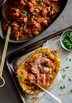 Roast spaghetti squash recipe with delicious sausage marinara sauce on @whiteonrice