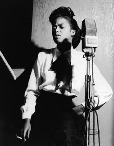 Sarah Vaughan at the microphone.