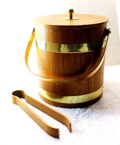 Jason loves this Vintage Wooden Ice Bucket with Brass Accents and Matching Ice Tongs, via Etsy.