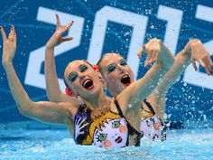 Russia's Natalia Ishchenko and Svetlana Romashina compete in the duets free routine final during the synchronized swimming competition.