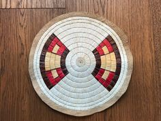 Quilled rosette created with naturally dyed quills using cochineal, bloodroot and walnut- offered by ebay seller bh.ranch