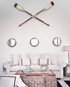 Gallery Wall above Sofa with mirrors and oars: http://www.completely-coastal.com/2015/03/coastal-nautical-cool-gallery-wall-ideas.html