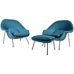 Early 1950s Pair of Eero Saarinen Womb Chairs with Ottoman for Knoll | From a unique collection of antique and modern lounge chairs at https://www.1stdibs.com/furniture/seating/lounge-chairs/