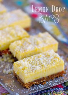 These Lemon Drop Bars are extra creamy and topped with candied lemon zest for the BIGGEST lemon flavor possible! So easy to make, deliciously sweet and tart, you'll find this treat hard to resist! // Mom On Timeout Lemon Dessert Recipes, Lemon Recipes, Easy Desserts, Sweet Recipes, Baking Recipes, Cookie Recipes, Delicious Desserts, Lemon Zucchini Cakes, Lemon Cheesecake Bars