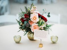 Amber had song lyrics printed for each guest table to go with her romantic blush, burgundy and gold centerpieces. | Photo by Jennifer Oetting Photography