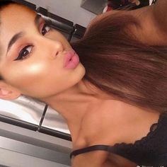 Ariana Grande Taking a selfie doing a cute kissy face.:).
