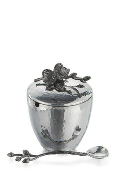 """The Michael Aram Black Orchid Collection was inspired by the powerful sensuality of orchids and the rich ambiance of haute couture – strikingly simple yet full of the most extreme detail.    Dimensions:3.25""""W x 4.25""""L x 4.25""""H, Spoon 5.25""""L;   Black-Orchid Mini Pot  by Micahel Aram. Home & Gifts - Home Decor Englewood, New Jersey"""