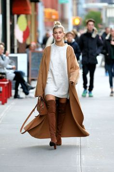 Who: Hailey Baldwin What: A Menswear Inspired Camel Coat Why: Baldwin embraces the season in over the knee boots, a sweater dress and a standout camel coat. Get the look now: Max Mara coat, $2,690,net-a-porter.com.