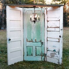 These old doors from Forever Vintage Rentals are perfect for taking photos in   at an outdoor wedding, but I'd love them in my garden every day!