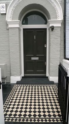Grey painted brick house with Path. Classic black and white Victorian mosaic main tile with classic border. Victorian Front Doors, Victorian Terrace, Victorian Homes, Victorian London, Victorian Front Garden, White Exterior Paint, Exterior House Colors, Exterior Design, Exterior Tiles