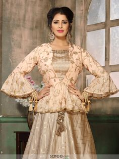 35 Latest Peplum Blouse Designs for Sarees and Lehengas Peplum blouse designs are in trend and this is why they are used by a lot of celebrities. The blouse design is the heavily enticing and with a modern look. In fact, peplum pattern is seen in the le… Indian Fashion Dresses, Indian Designer Outfits, Pakistani Dresses, Designer Dresses, Fancy Blouse Designs, Saree Blouse Designs, Lehenga Designs, Peplum Blouse, Peplum Outfit