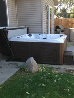 Here is a Master Spas Healthy Living hot tub with cover lifter installed on a concrete patio.