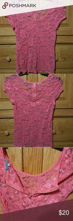 NWOT SHEER BLOUSE NWOT Very dressy /_sexy  sheer blouse . Never worn  Zipper opening in back Looks great with a Cami underneath Kind of a coral color charlette Russe Tops Blouses