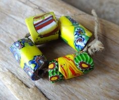 "Set of 4 colorful vintage African trade beads also as know Venitian glass beads with some composite murrini.   The bead size are approximately:  1 bead measure 13 by12  1 bead "" "" "" 14 by 9  1 bead "" "" "" 16 by 9  1 bead "" "" "" 17 by 8"