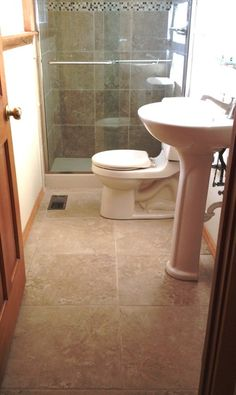 Love the floor for a small bathroom
