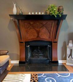This Art Nouveau fireplace mantel is by Michael Evans Design.