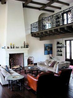 spanish interior.  white plaster.  dark trim.
