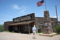 Boothill Graveyard, Tombstone. Inspiration for historic graveyard in the city of Redemption (that's my driver/dad standing in front of it)
