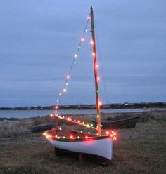 Sailboat with christmas lights.   Use as a landscape for pictures.  Supply santa hats, goggles, swim cap, life preserver, oars, christmas sweaters, Make a frame where sail would be and use as a message board out of a huge white board.