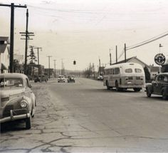 "N.E. corner of 5th Street and Broadway looking east on 5th Street. 1950s. Scenes of Vancouver before I-5. From the Munro-Watson Collection. Donated by Joan Munro Watson, daughter of Francis Tresyhair and Sarah ""Nancy"" Annie Munro. F.T. Munro owned an automobile repair business (Munro & Bolma) and worked as a photographer on the side. Mr. Munro was also a member and president of the Vancouver Camera Club. The Munro family lived on and worked a 10 acre prune orchard and chicken farm in…"