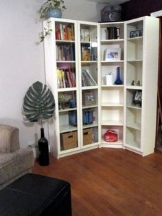 This is three white BILLY bookcases from Ikea, two narrow and one small, with corner hardware, and the BILLY all-glass doors which will hopefully keep the ...