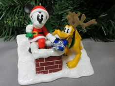 Look who is helping Santa deliver presents!  It's Mickey Mouse and Pluto
