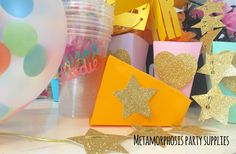 Image of Party boxes, bags, straws, cups and balloons